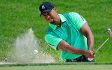 BETHESDA, MD - JUNE 26:  Tiger Woods of the United States hits out of the bunker on the third hole during the first round of the Quicken Loans National at Congressional Country Club on June 26, 2014 in Bethesda, Maryland.  (Photo by Rob Carr/Getty Images)